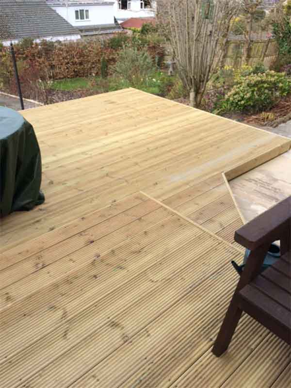 Raised wooden deck East Kilbride creating an evening sun trap and BBQ area